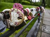Multi-colored Padlocks With Missing Keys On The Bridge Are Symbols Of Fidelity And Love. Bridge With poster