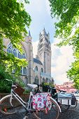 Beautiful View Of The Cathedral Of St. Salvator In Bruges With Bright Green Tree Crowns And Sun Rays poster