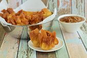 Deep Fried Chicken Wonton Served With Peanut Sauce poster