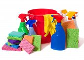 picture of spring-cleaning  - a variety of cleaning supplies and chemicals on a white background including spray bottles gloves sponges rags and a bucket - JPG