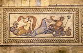 stock photo of poseidon  - An ancient floor mosaic made of tiles that shows an image of Poseidon riding with Ampitrite his wife or consort on the sea horse Hippokampos - JPG