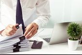 Businessmen Are Searching For Documents Lying On The Table,business Report Papers,important Document poster
