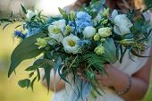 Bridal Bouquet. Wedding Bouquet In The Hands Of The Bride. Outdoor Shot In Evening. Rustic Or Boho S poster