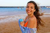 Happy Bikini Woman On The Beach. Portrait Of Beautiful Girl With Wind Fluttering Hair And Pareo. Sum poster