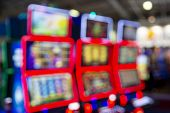 Out Of Focus Blurry Image Of Casino Equipment. Blurred Slot Machines In A Casino. poster