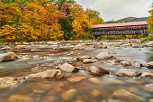 Swift River and old covered Albany Bridge at autumn in White Mountain National Forest, New Hampshire poster