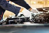 The Car Mechanic Is Checking The Engine Oil Level.auto Mechanic Preparing For The Work.close Up Of H poster
