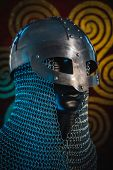 Traditional Vikings, viking helmet with chain mail on a red shield with golden shapes of sun, weapon poster