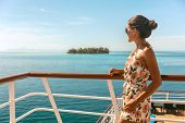 Cruise ship travel vacation luxury tourism woman looking at ocean from deck of sailing boat. Luxury  poster