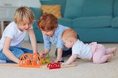 Cute Kids, Siblings Playing Toys Together On The Carpet At Home poster