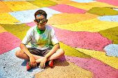 Boy After The Crazy Color Run Marathon Sitting On A Colorful Map. Copy Space For Your Text poster