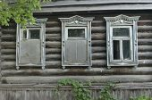 Boarded Up Windows On The Old Wooden Wall Of The House. Carving Adorns The Old Window. The Walls Of  poster