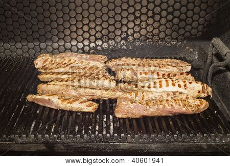 cooking meat on the grill