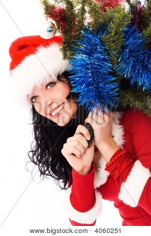Beautiful Brunette Woman Carrying A Christmas Tree