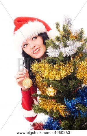 Beautiful Woman Decorates A Christmas Tree