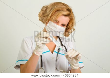 Beautiful Doctor  In Gloves Showing Ampule