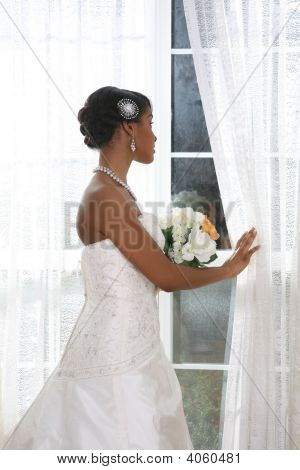 Beautiful Young Bride Looking Out Window