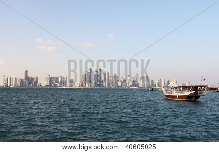 The skyline of Doha, Qatar, in the last days of December 2012, with a dhow in the foreground.