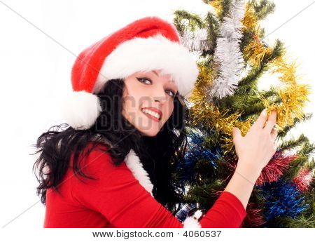 Beautiful Brunette Woman Near The Christmas Tree