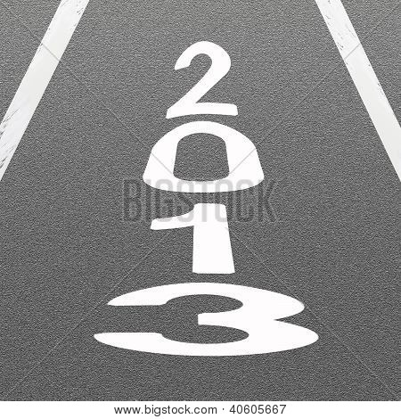 Signal Arrow And Word 2013 On Asphalt Road Background
