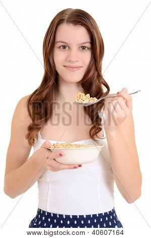 Teen girl eating cereal