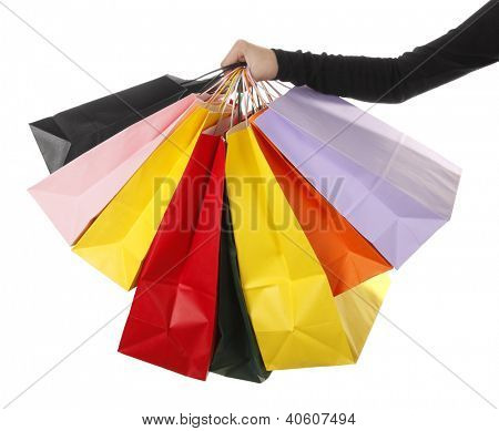Woman is holding colorful shopping bags