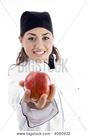 Professional Female Chef Showing Fresh Apple