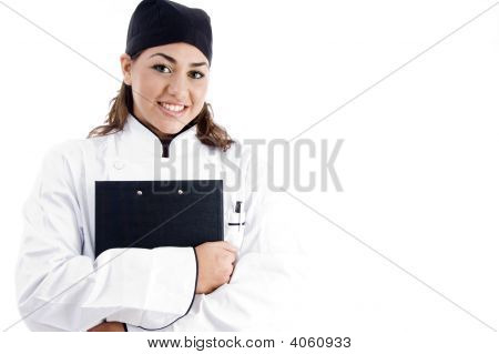 Beautiful Female Chef Holding Notepad