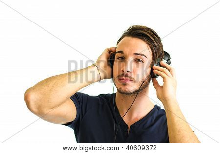 Handsome Young Man Listening To Music On Headphones