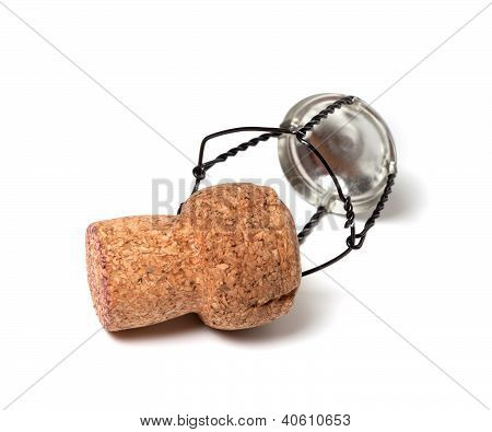 Champagne Wine Cork And Muselet On White Background