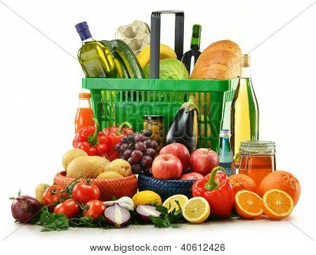 Composition With Groceries And Basket Isolated On White.