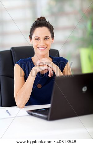 lovely young white collar worker sitting in office