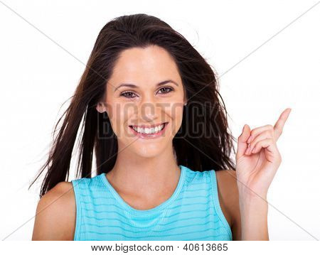 happy young woman pointing at copyspace