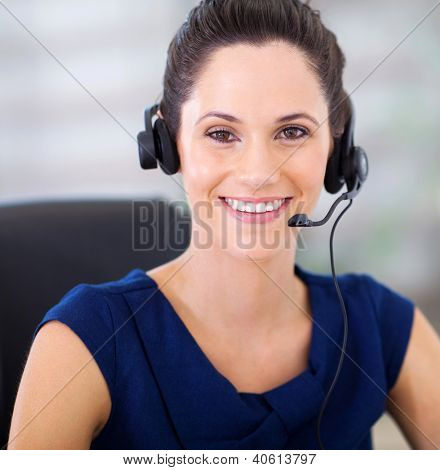 pretty young telephonist with headphones closeup portrait