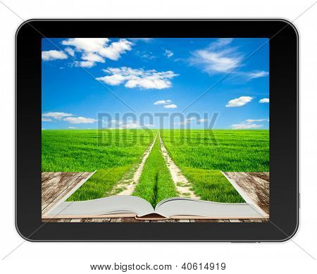 Open book with ground road on green field in black tablet like Ipade . Concept of fantasy when you read books