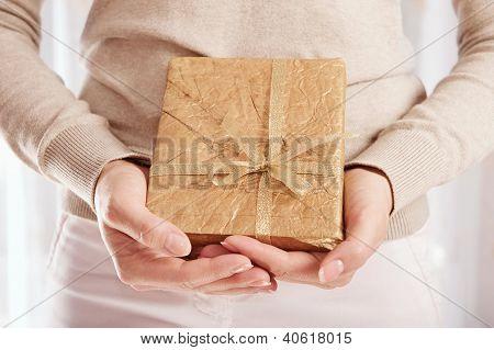 Christmas Present In Golden Wrap