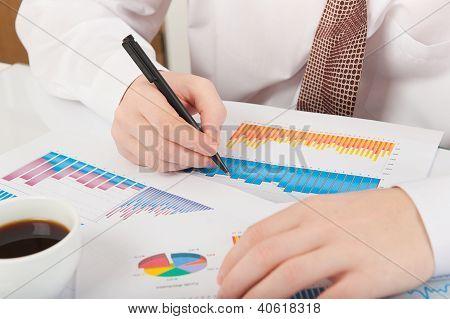 Businessman Analyzing Graphs