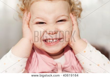 Excited Baby Girl Leaning On Her Hands