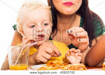 Child Drinking Juice And Eating Pizza