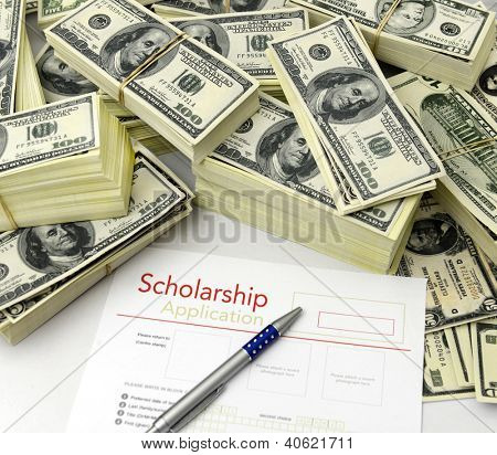 Scholarship application form  with a with a bunch of  US dollar bill