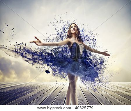 Ballerina with a blue dress with blue paint