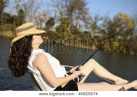 Mature Woman Fishing on a Boat