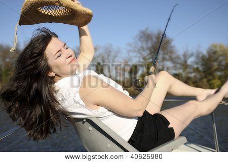 Mature Woman Fishing on a Boat