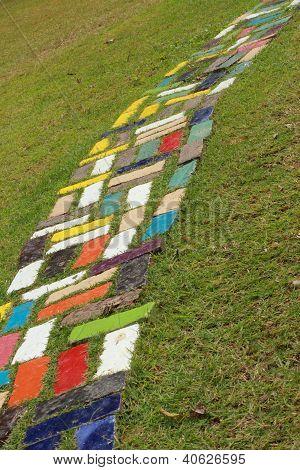 Floor tiles on green grass