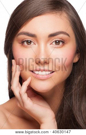 Portrait of pretty young woman with beautiful healthy skin touching her cheek. Isolated on white background