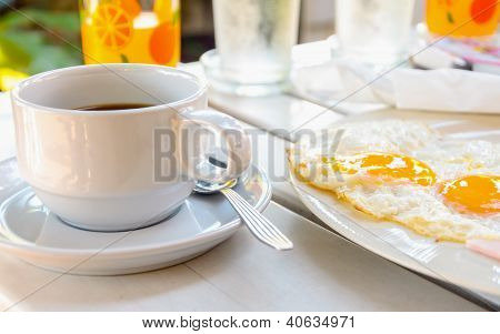 Cup Of Coffee With Breakfast Fried Egg