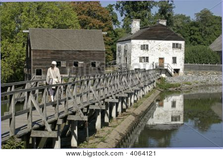 Colonial Grist Mill And Wooden Bridge
