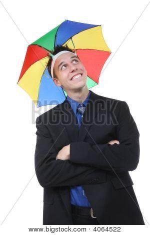 Business Man Under Umbrella