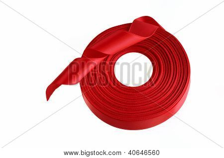 Red Ribbon Roll On A White Background