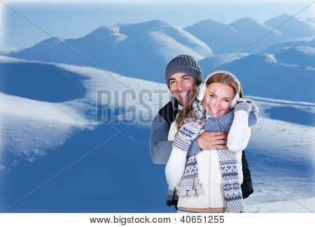 Image of happy couple hugging outdoors, young loving family having fun in snowy mountains, handsome man embracing his cute girlfriend, honeymoon in wintertime, winter holidays, love concept